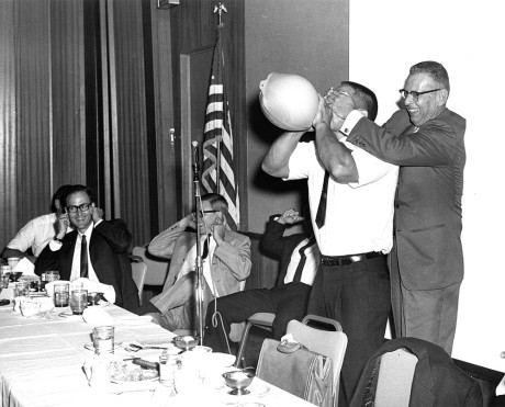 Bill Pearl bursting hot water bottle.