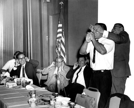 Bill Pearl blowing up hot water bottle.