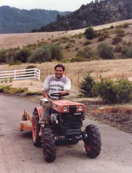 Bill Pearl on a tractor.